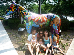 Zach, Amanda and Milly Dotsey with Andra, Jackson (pouting) and Addison Sawyer in front of one of Lexington, KY's Painted Ponies