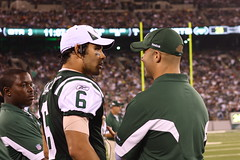 NY Jets QB Mark Sanchez and assistant coach Sal Alosi's back..