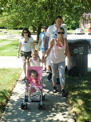 Amanda, Erin and Milly Dotsey; Josh, Andra, Addison and Jackson Sawyer going for a walk in Lexington, Kentucky