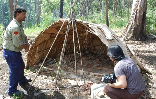 Ranger guide explaining how huts are made