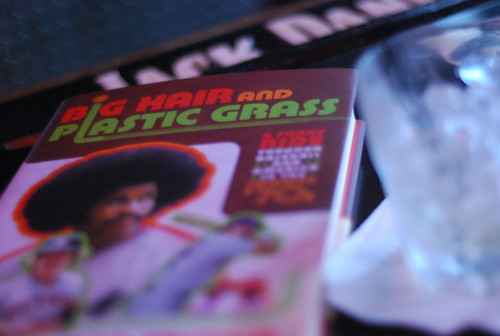 big hair & plastic grass reading and signing