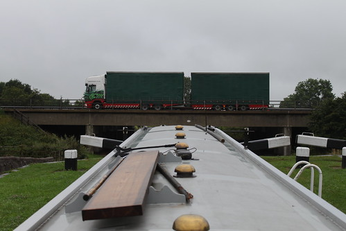 Stobart vs barge - the M6 seen from Lock 58, Hassall Green
