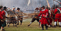 Pikemen engage musketeers during a re-enactmen...