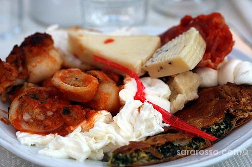 Stuffed calamari, torta salata and cheeses at a Pugliese wedding in Abruzzo