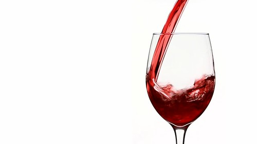 Pouring Red Wine Into Empty Wine Glass in Slow...