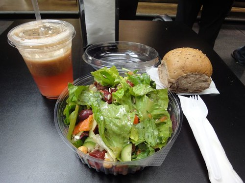 Juice, salad and bread roll