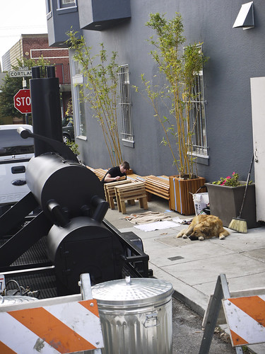 the designer installing new benches at Sandbox; gorgeous work!