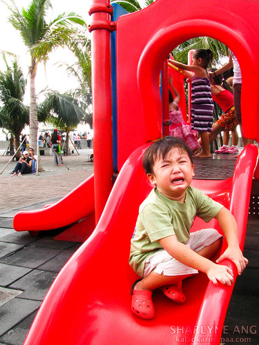 Child Crying in a Red Slide