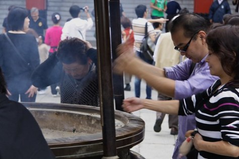 Wafting insense smoke for good luck, Sensö-ji Temple