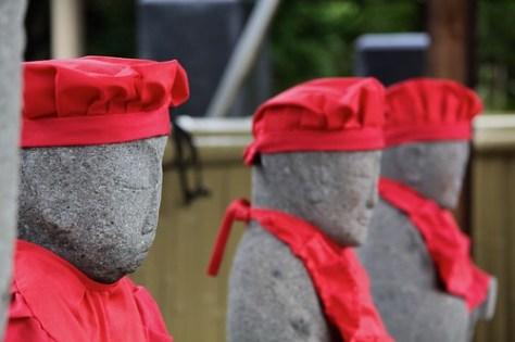 Statues in bibs