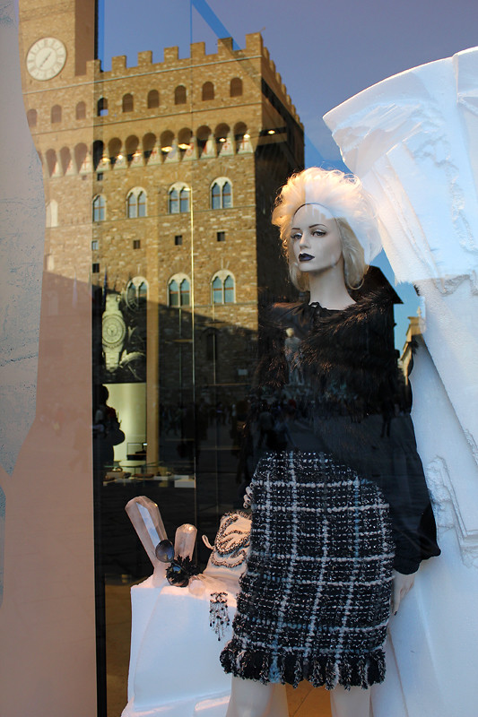 Channel window display with a reflection of Palazzo Vecchio
