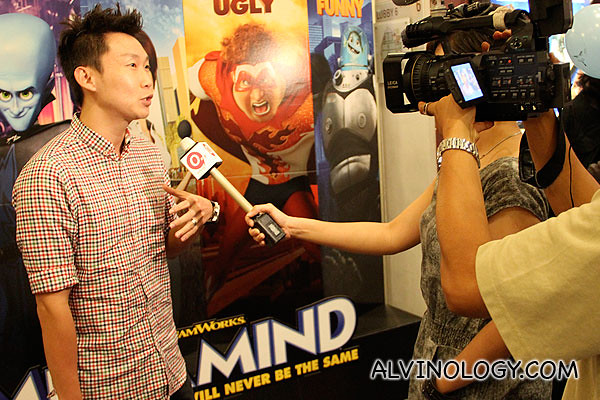 Fashion designer, Keith Png getting interviewed