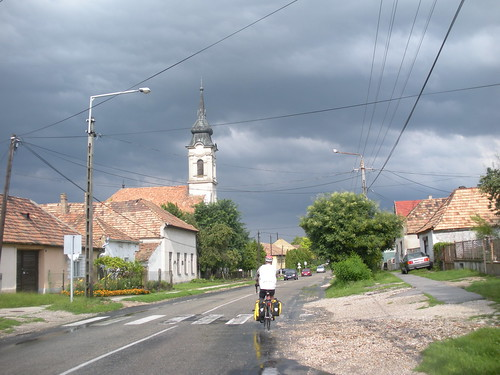 On the road in Hungary under thundery skies