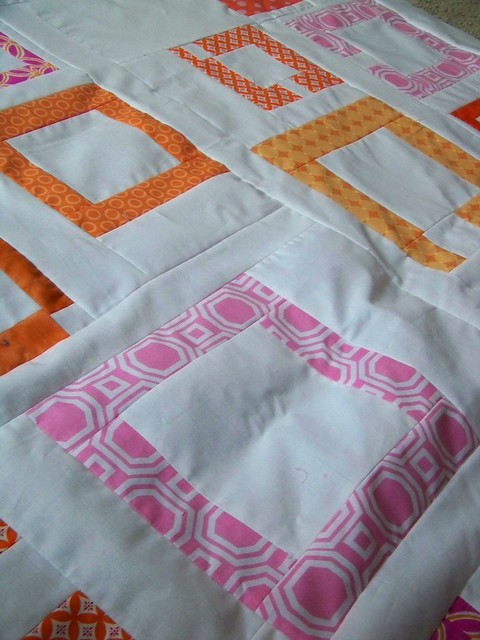 orange and pink patchwork modern quilt top