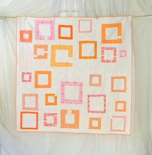modern improv square quilt pink and orange on white background
