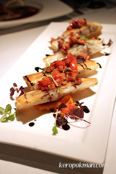 Sea bream blanketed with crispy brick phyllo on butternut pumpkin puree top with tomato salsa