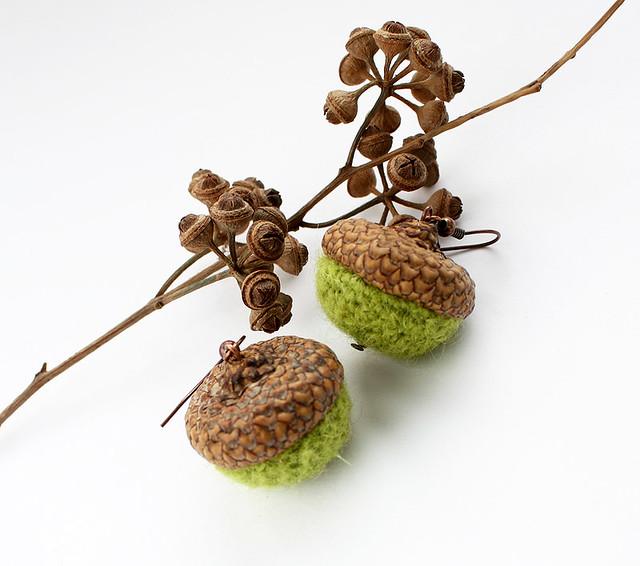 Crocheted green earrings in a form of acorn