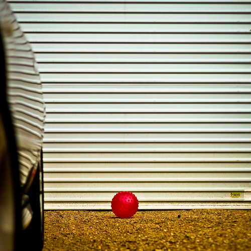 red ball on crushed rock by Matt Hovey
