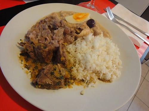 Seco de cordero, frejoles, aji de gallina, white rice