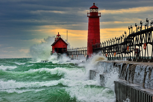 """""""September Gale""""  Grand Haven Breakwater Lighthouse is located in the harbor of Grand Haven, Michigan"""