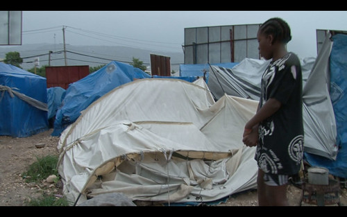 Girl-looking-at-Destroyed-Tent