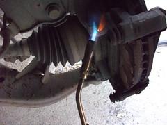 Heat caliper bolts to loosen
