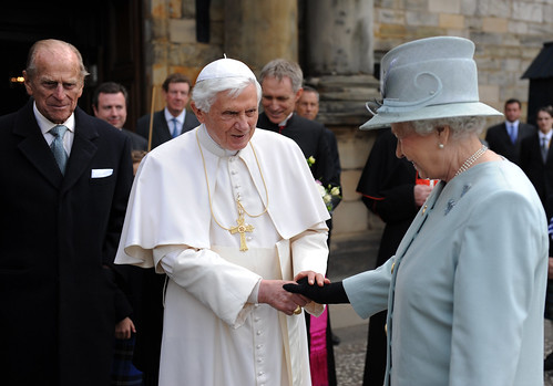 Queen Elizabeth II, wearing gloves, shakes Pope Benedicts hand, 2010. Flickr/Creative Commons