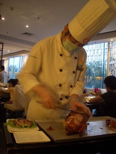 Carving duck at Da Dong Restaurant