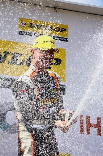 Matt Neal celebrates his BTCC win on the podium at Thruxton, May 2017