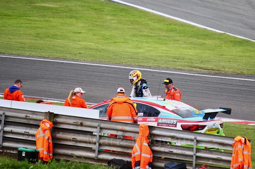Tom Ingram gets out of his stricken car off the track at Oulton Park, May 2017