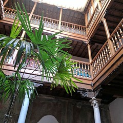 Balconies and palms. Our 16th century Granada hotel