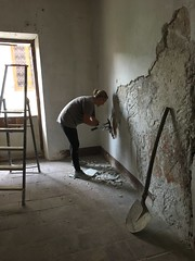 Removing the old plaster from mid he walls at ground floor