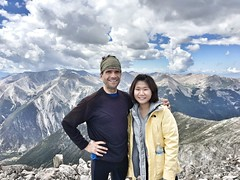 On top of Mount Princeton with Xiaoen Ding looking south.  That's 14er Mount Antero behind us.
