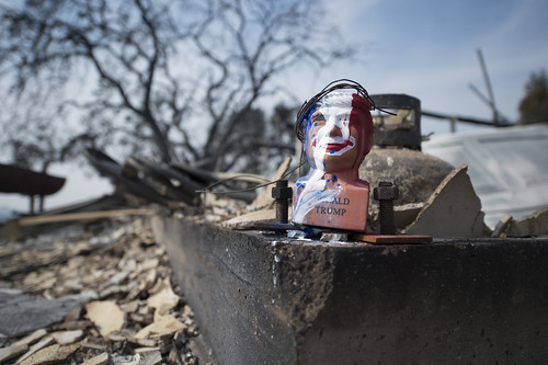 A multi-color Donald Trump bust is found half-melted in what was formerly the garage of a house in Sonoma County, California. The house was completely burnt down by the fire that devastated Sonoma, Napa and Santa Rosa, October 17, 2017.
