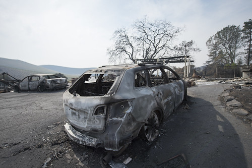 The remains of a burnt vehicle in front of a house in Sonoma County, California after the recent devastating fire. The wineries in the area are known for producing wine and wine tasting, October 17, 2017