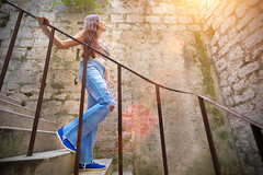 Woman descends down the stairs and looking top