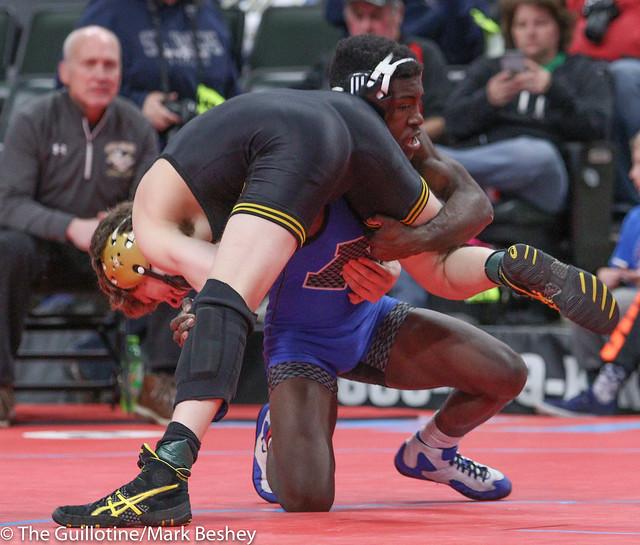Quarterfinal - Boyd Mumbuwa (Minnetonka) 48-5 won in sudden victory - 1 over Adam Mickelson (Apple Valley) 21-6 (SV-1 6-4) - 180302bmk0020