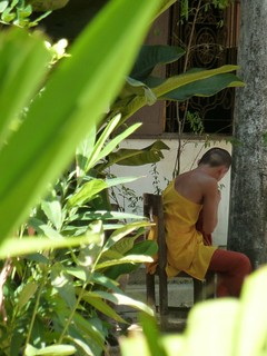 chela washing clothes, Buddhist college, Pattaya, Thailand