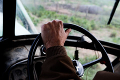 Stewart steers his tractor while on his way to feed his cows.