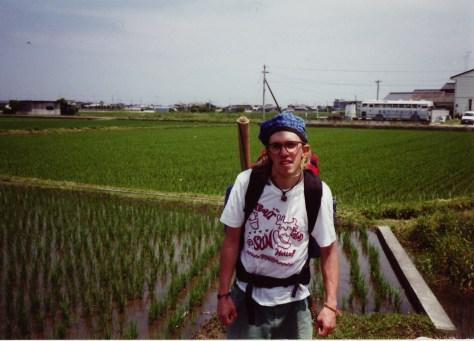 hitchhiking in japan by rice paddies