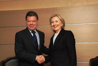 Secretary Clinton Shakes Hands With Colombian Presidential Candidate Juan Manuel Santos