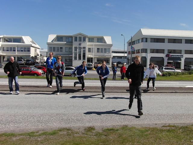 Team Faroe running across a street in Hafnarfjörður