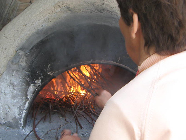 Firing up wood oven for flaounes