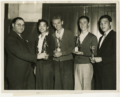 Awarding trophies to captains of winning teams, October 14, 1937