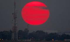 Sun set on Israel-Gaza border, by Yannis Behrakis)