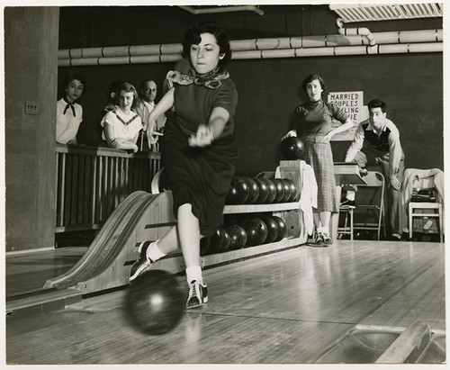 Woman bowling, taken around 1950