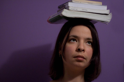 Image of woman balancing books on her head