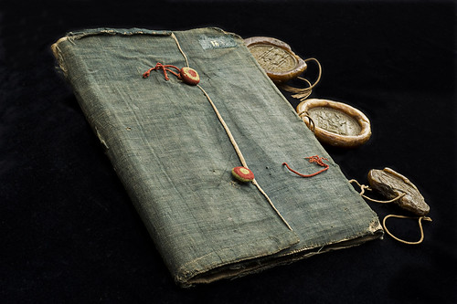 Limp cloth binding, Sweden, 1451-1452. Medieval limp cloth binding of linen with three seals.