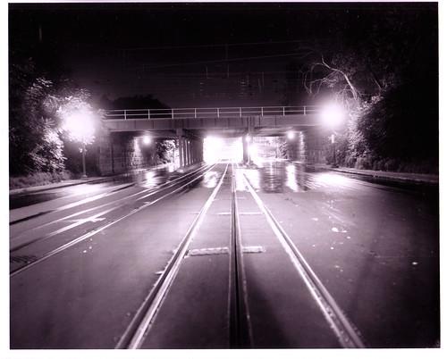 Tracks go under the railroad bridge, by By DDOTDC