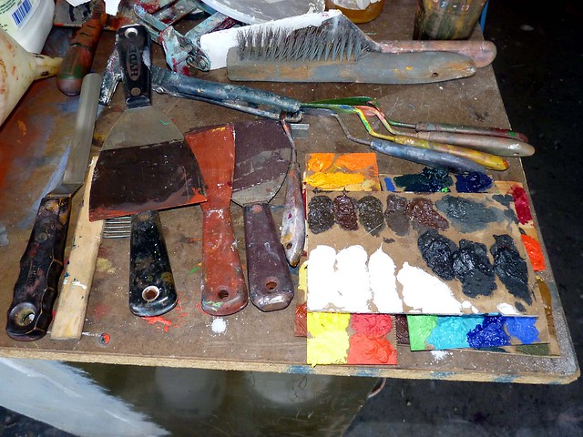 Dried paint samples and scraping tools